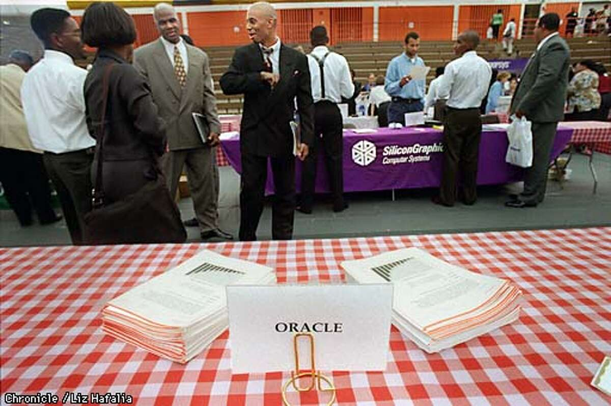 The National Society of Black Engineers held a job fair as part of their conference at Santa Clara University. The Oracle desk was unattended during the job fair. Photo by Liz Hafalia
