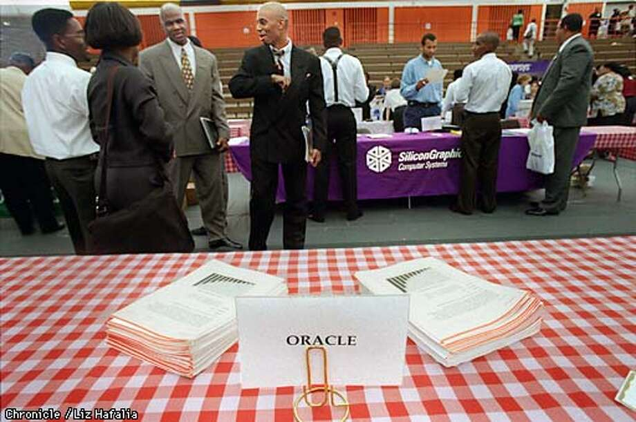 The National Society of Black Engineers held a job fair as part of their conference at Santa Clara University. The Oracle desk was unattended during the job fair. Photo by Liz Hafalia Photo: Liz Hafalia