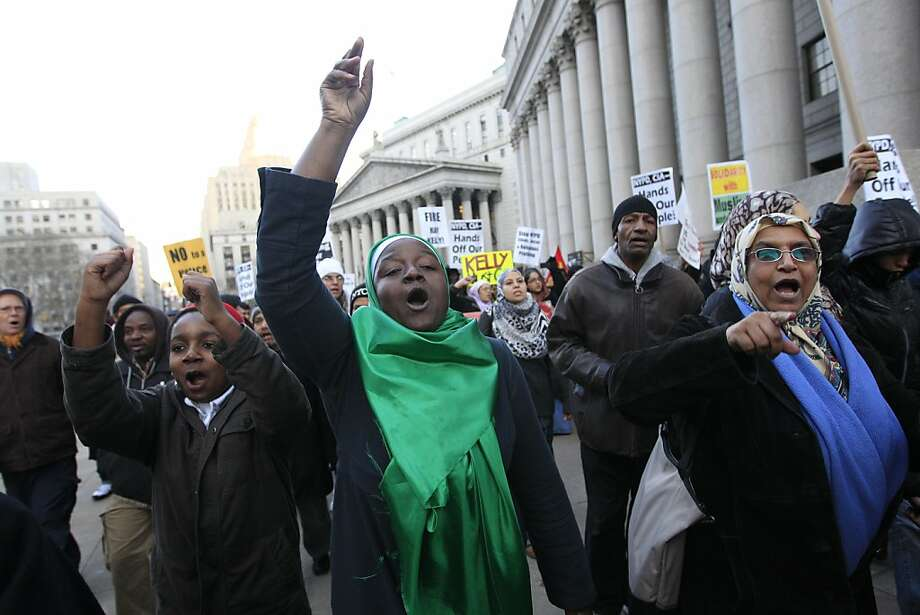 Fatima Akbar, center, marches with her son Shafiyu, 11,  left, and Ayesha Mohammed, right, towards the New York Police Department headquarters during a rally asking for the resignation of NYPD Commissioner Ray Kelly and NYPD spokesperson Paul Browne, in a demand for independent community control of the NYPD, and a well-funded oversight mechanism with subpoena power, Friday, Feb. 3, 2012 in New York.  Thirty-three civil rights groups from around America complained to the New York attorney general Friday about police documents that showed the New York Police Department recommending increased surveillance of Shiite mosques based solely on their religion. The letter urged Attorney General Eric Schneiderman to investigate NYPD's surveillance operations, which monitored entire neighborhoods and built databases about everyday life in Muslim communities. Photo: Mary Altaffer, Associated Press