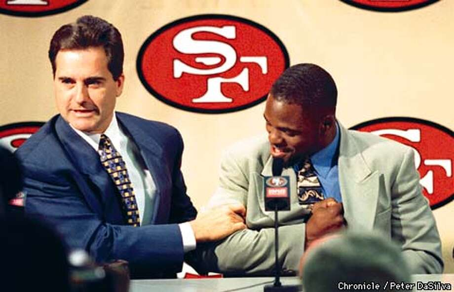 49ers head coach Steve Mariucci, left, shows off R.W. McQuarters strength as he flexed his biceps during a press conference introducing 49er draft picks R.W. McQuarters, Jermey Newberry and Chris Ruhman . Chronicle Photo By:Peter DaSilva Photo: Peter DaSilva