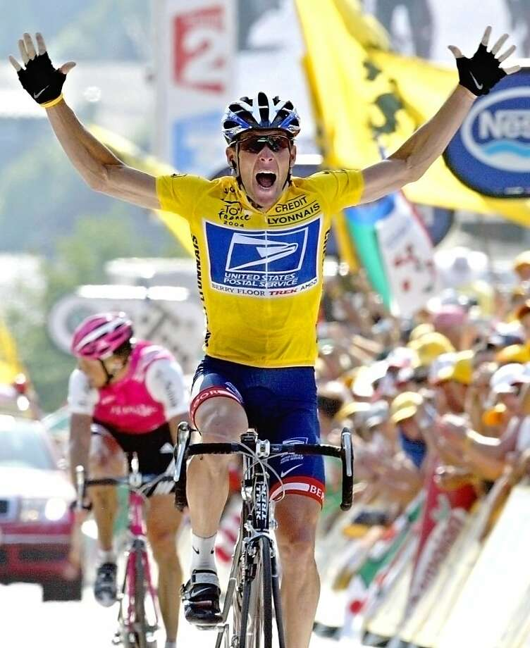 CORRECTS YEAR OF FILE PHOTO TO 2004, NOT, 2005 - FILE - In this July 22, 2004, file photo, overall leader Lance Armstrong reacts as he crosses the finish line to win the 17th stage of the Tour de France cycling race between Bourd-d'Oisans and Le Grand Bornand, French Alps. Federal prosecutors said, Friday, Feb. 3, 2012, they are closing a criminal investigation of Armstrong and will not charge him over allegations the seven-time Tour de France winner used performance-enhancing drugs. (AP Photo/Laurent Rebours, File) Photo: Laurent Rebours, Associated Press