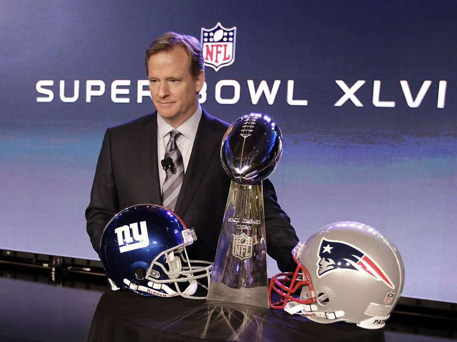 NFL Commissioner Roger Goodell poses with the Vince Lombardi Trophy after a news conference Friday, Feb. 3, 2012, in Indianapolis. The New England Patriots will face the New York Giants in Super Bowl XLVI on Feb. 5. (AP Photo/David J. Phillip) Photo: David J. Phillip, Associated Press