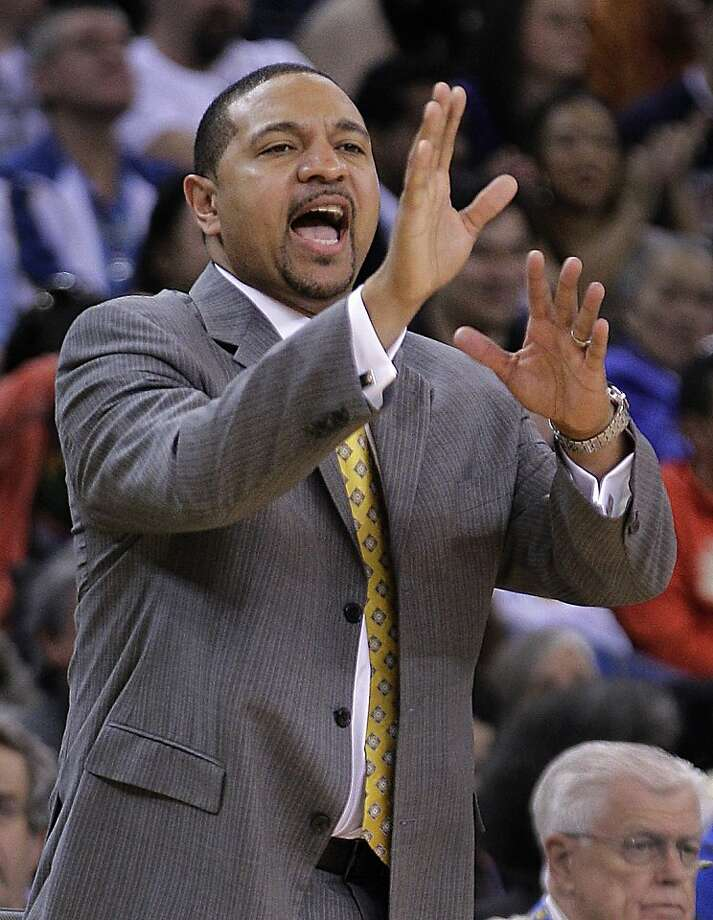 ADVANCE FOR WEEKEND EDITIONS FEB. 4-5 - In this photo taken, Jan. 31, 2012, Golden State Warriors coach Mark Jackson gestures from the sidelines during the second half of an NBA basketball game against the Sacramento Kings in Oakland, Calif. Jackson had just arrived at the scene of a fiery crash near his Southern California home last October when he spotted a pair of familiar feet trapped under the passenger seat. The 1995 Chrysler LeBaron, purchased by the Golden State Warriors coach so a family without transportation could attend his ministry, was in flames. (AP Photo/Ben Margot) Photo: Ben Margot, Associated Press