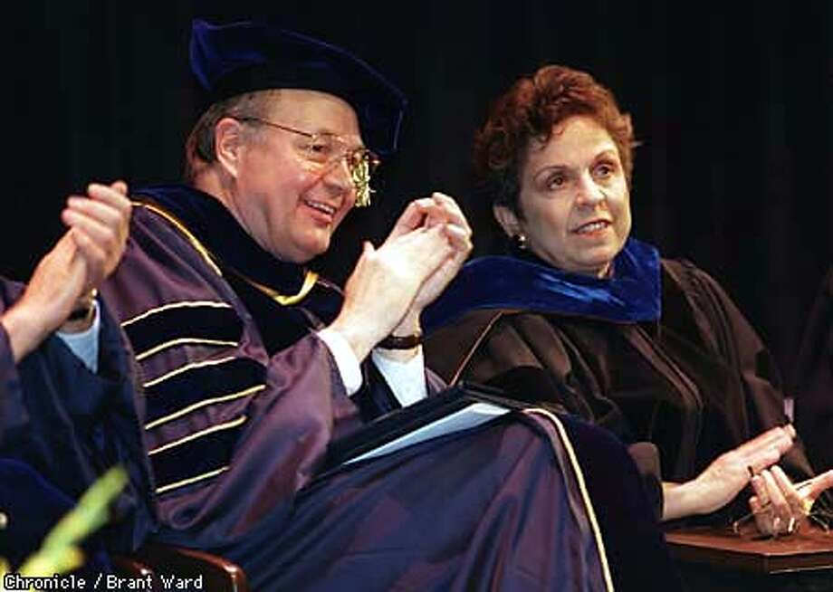 New Berkeley Chancellor Robert M. Berdahl applauded a speaker as he sat next to U.S. Secretary of Health and Human Services Donna Shalala Friday during ceremonies at Zellerbach Auditiorium. By Brant Ward/Chronicle