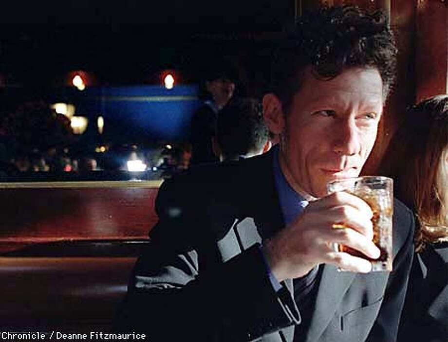 "Musician/actor Lyle Lovett has a drink in Harry's Bar on Fillmore Street before going to the Clay Theater for the film festival screening of ""The Opposite of Sex"" in which Lovett stars. CHRONICLE PHOTO BY DEANNE FITZMAURICE"