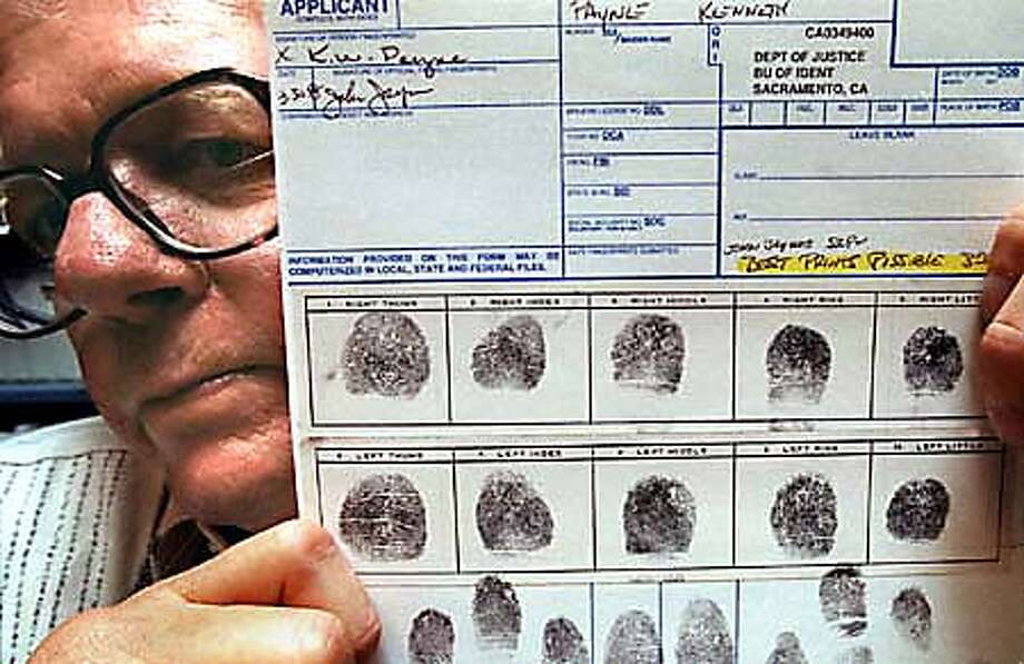 Ken Payne holds a copy of his fingerprints, which the state claims are not clear enough for him to teach anymore. By Brant Ward/Chronicle