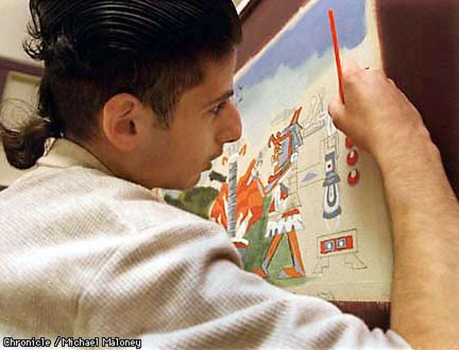 Eighteen year old artist DannyAlahwal works intently on a mural in the hallway of his South SF school. Northstars School #1 is a school for at risk students who created beautiful murals in the halls of the school. The school district however is planning to tear the school down. The students want to find a way to save their murals.  Photo by Michael Maloney Photo: MICHAEL MALONEY