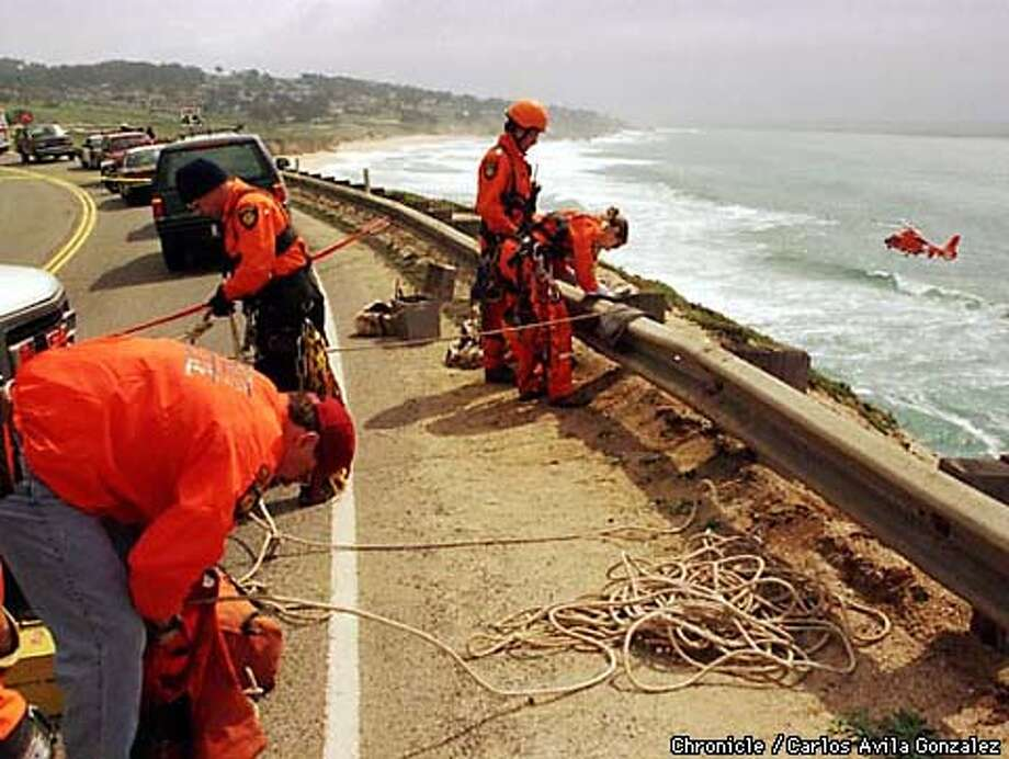 San Mateo County Sherriff's Rescue team members check the cliffside on Devil's Slide where a rental van went over the edge, ejecting the driver who was not found after witnesses said they saw him in the water. A U.S. Coast Guard helicopter and ship searched the water for several hours after the accident but could find no one in the water. (CHRONICLE PHOTO BY CARLOS AVILA GONZALEZ) Photo: CARLOS AVILA GONZALEZ