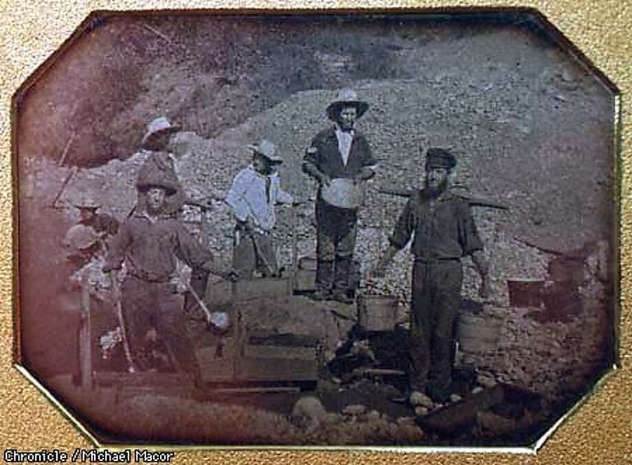 """"""" The California Gold Rush Experience"""" on display at the Bancroft Library at UC Berkeley. Runs from March 20 through August 30. A Daguerreotype from Ca. 1850 shows six miners and their mining equipment. By Michael Macor/The Chronicle Photo: MICHAEL MACOR"""