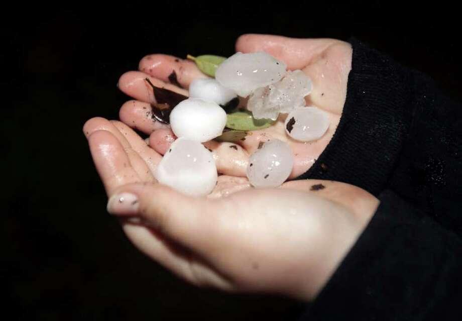 Hail pelted northwest central San Antonio near the Jefferson Area. Friday, Feb. 3, 2012.  Bob Owen/San Antonio Express-News Photo: Bob Owen, San Antonio Express-News / © 2012 San Antonio Express-News