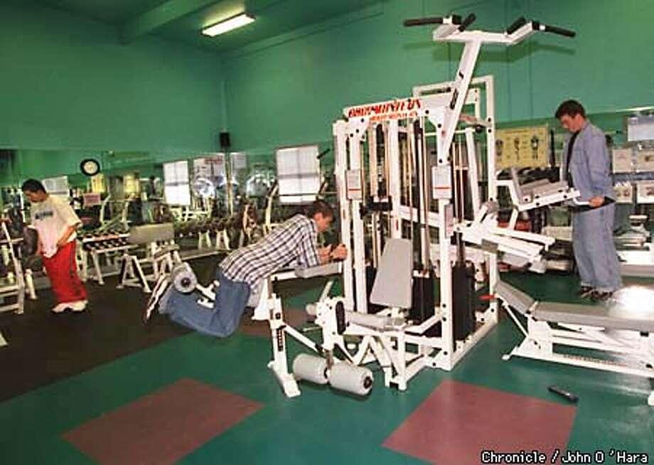 Gym, workout facilities. (left to right) Jorge Ramos 18, Andres Quinteros 15, and Justin Barwick 15.  Photo by..........John O'Hara