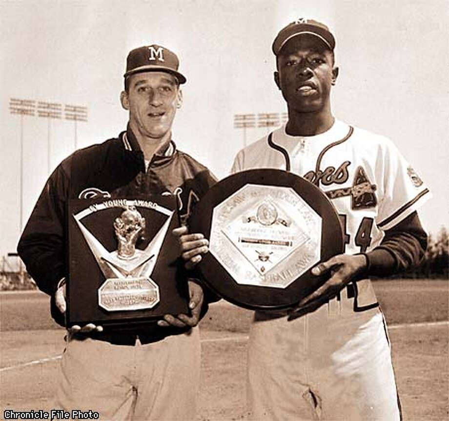 Warren Spahn, left, and Hank Aaron of the Milwaukee Braves. Spahn received the Cy Young award as the most valuable pitcher in the major leagues for 1957. Aaron received the Kenesaw Mountain Landis memorial plaque as the National League's Most Valuable Player, April 26, 1958. Photo: DVN