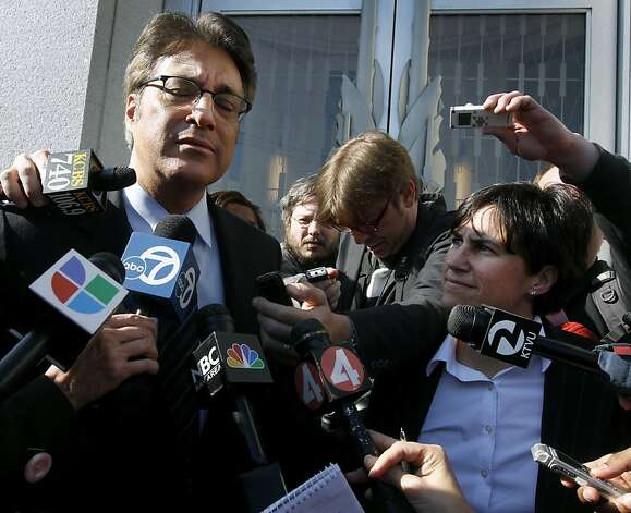 Sheriff Ross Mirkarimi fights back tears as he describes his frustration that he still can't see his son Theo after attending a hearing at the Civic Center Courthouse to decide whether to allow visitation in San Francisco, Calif. on Friday, Feb. 3, 2012. Standing with Mirkarimi is his attorney Lidia Stiglich (right). The judge postponed any decision until next Wednesday. Photo: Paul Chinn, The Chronicle