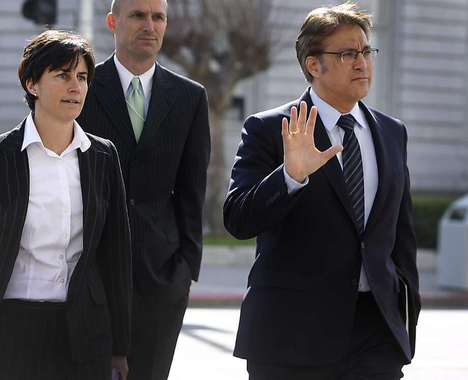 Sheriff Ross Mirkarimi waves as he arrives at the Civic Center Courthouse with his attorney Lidia Stiglich to attend a hearing to decide whether to allow visitation with his son Theo in San Francisco, Calif. on Friday, Feb. 3, 2012. The judge postponed any decision until next Wednesday. Photo: Paul Chinn, The Chronicle