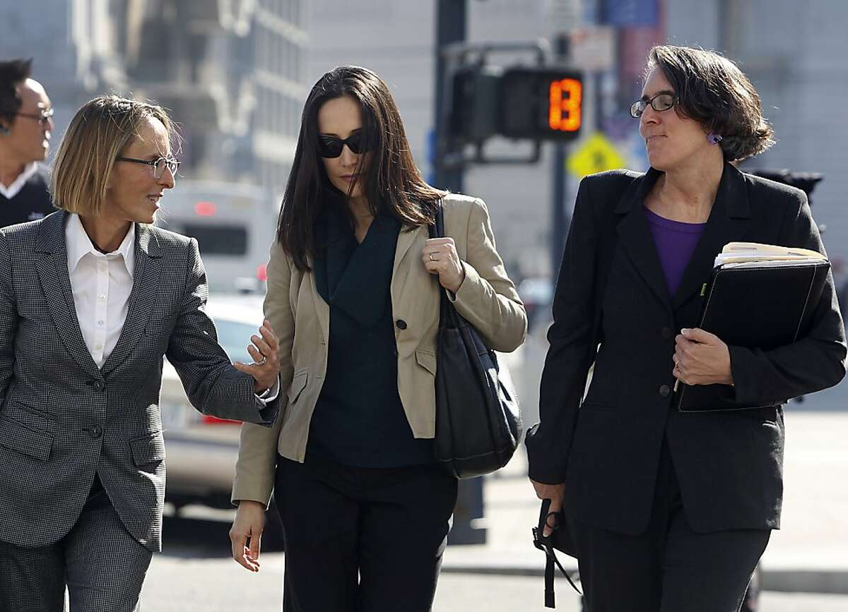 Eliana Lopez Urbina, wife of Sheriff Ross Mirkarimi, arrives with her attorneys Paula Canny (left) and Deborah Wald (right) to attend a hearing at the Civic Center Courthouse to decide whether to allow Mirkarimi visitation with his son Theo in San Francisco, Calif. on Friday, Feb. 3, 2012. The judge postponed any decision until next Wednesday.