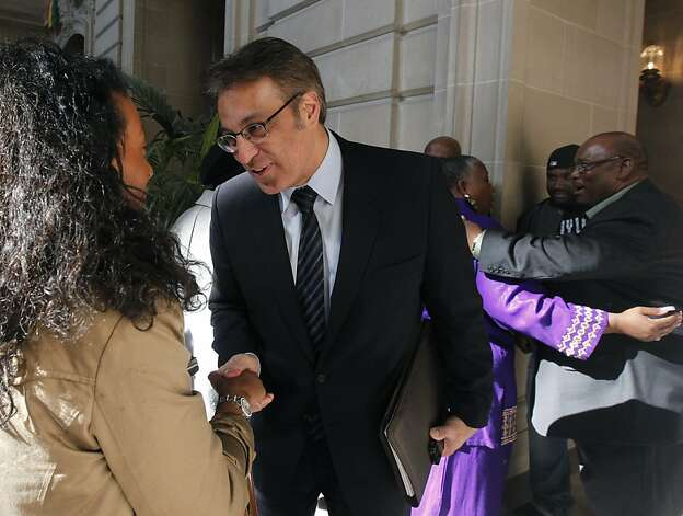 Sheriff Ross Mirkarimi speaks with Maria Costen after attending a Black History Month celebration at City Hall in San Francisco, Calif. on Friday, Feb. 3, 2012, minutes before a hearing to allow him visitation with his son Theo. The judge postponed a ruling until next Wednesday. Photo: Paul Chinn, The Chronicle