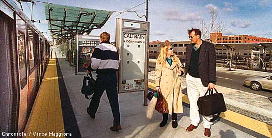 = L TO R Terry Hertzig and Atta Pilram waiting to get on the E-Line the shuttle that takes them from Caltrains on 4th st to the Embarcadero Mumi Station SF. by Vince Maggiora Photo: VINCE MAGGIORA