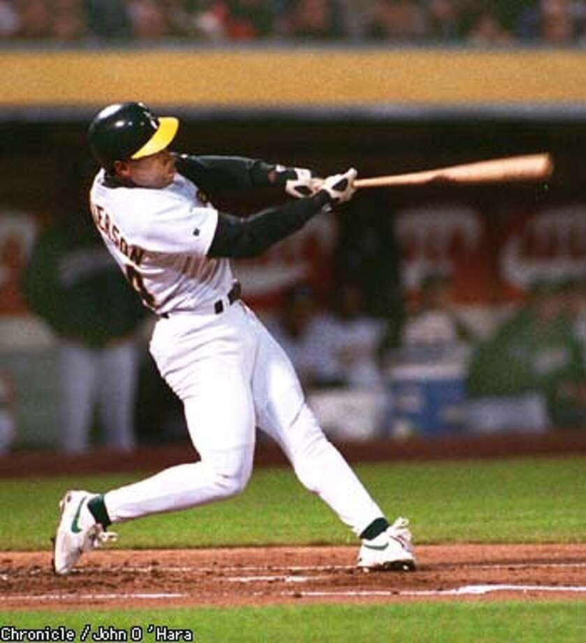 Opening day, Rickey Henderson the lead off batter flew out at his first at bat as an A's player in 1998  Photo by............john O'Hara
