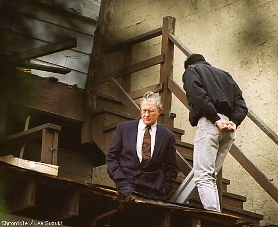HALLINAN/27FEB96/MN/LS--District Attorney Terrence Hallinan checked out the broken deck at 2003 Franklin Street shortly after the accidental death of a Marin woman. By Lea Suzuki/Chronicle