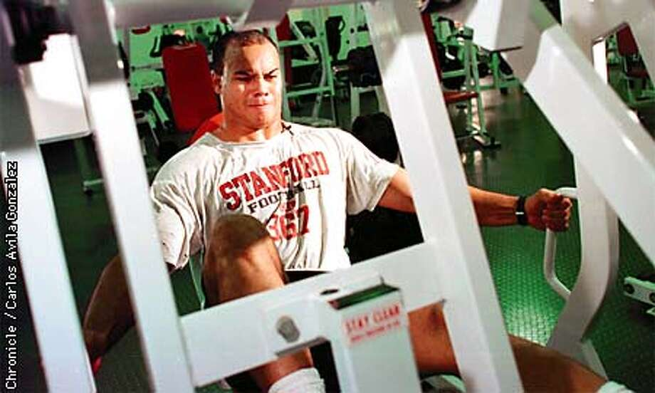 Stanford football player Kailee Wong working on leg lifts during a workout at Stanford University on Monday, April 13, 1998. Wong will be drafted by the NFL this weekend. (CHRONICLE PHOTO BY CARLOS AVILA GONZALEZ) Photo: CARLOS AVILA GONZALEZ