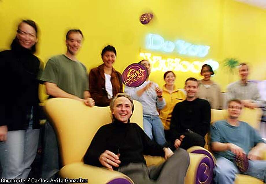 Yahoo! President and CEO Tim Koogle, seated center, with executives of Yahoo! Inc., which is venturing into the Internet Service Provider business in addition to its online service. (CHRONICLE PHOTO BY CARLOS AVILA GONZALEZ) Photo: CARLOS AVILA GONZALEZ