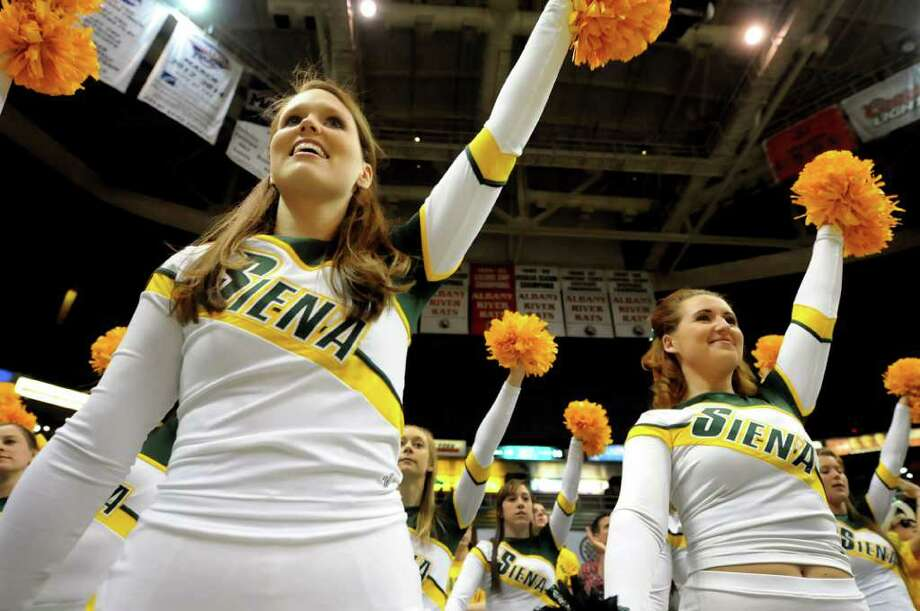 Siena cheerleaders Kathleen Hess, 21, left, and Amanda Willey, 21, right, show support for their team during their basketball game against St. Peter's on Friday, Feb. 3, 2012, at Times Union Center in Albany, N.Y. (Cindy Schultz / Times Union) Photo: Cindy Schultz /  00015373K