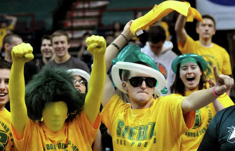 Siena fans Anthony Grieco, 20, left, and A.J. Hare, 20, center, cheer in the student section during their basketball game against St. Peter's on Friday, Feb. 3, 2012, at Times Union Center in Albany, N.Y. (Cindy Schultz / Times Union) Photo: Cindy Schultz /  00015373K