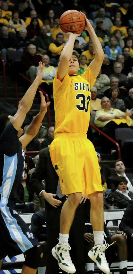 Siena's Rob Poole (33) shoots for three during their basketball game against St. Peter's on Friday, Feb. 3, 2012, at Times Union Center in Albany, N.Y. (Cindy Schultz / Times Union) Photo: Cindy Schultz /  00015373K