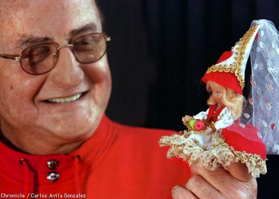 Albert Bourlas, a former San Francisco and Peninsula restaurateur, is now heading the Nancy Abbott Doll Company, which produces collectable dolls from the Nancy Abbott storybooks. He bought the company for a song in 1967, and recently revived production of the dolls. He is holding the Queen of Hearts doll. (CHRONICLE PHOTO BY CARLOS AVILA GONZALEZ) Photo: CARLOS AVILA GONZALEZ