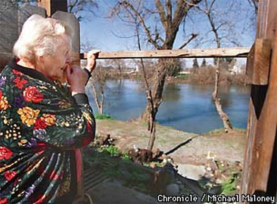 Dorothy Newell worries that the Tuolumne River behind her home will rise again as it did last year flooding her home in the Riverbend subdivision in Modesto.  With the high demand for affordable housing in California, developers are building in floodplains often figuring the the slight chance of fooding is worth the risk. Last year, homes in the Riverbend subdivision along the Tuolumne River in Modesto flooded even though the homes were outside the 100 year flood plain.  PHOTO BY MICHAEL MALONEY Photo: MICHAEL MALONEY