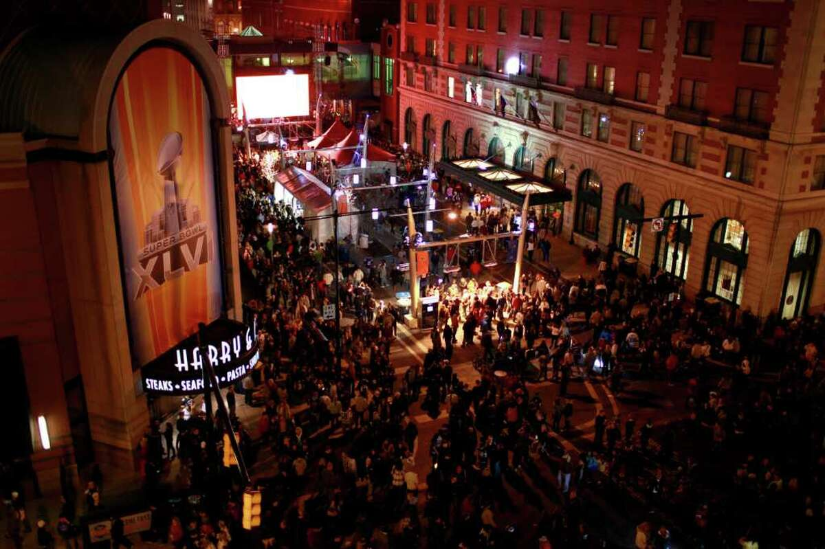 People crowd the streets through Super Bowl Village on Friday, Feb. 3, 2012, in Indianapolis. The New England Patriots are scheduled to face the New York Giants in NFL football's Super Bowl XLVI on Feb. 5. (AP Photo/Jeff Roberson)