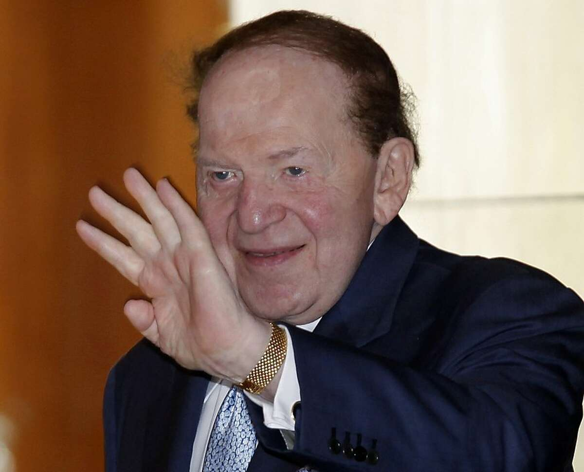 """FILE - In this June 7, 2011 file photo shows Las Vegas Sands Chairman and CEO Sheldon Adelson waves in Hong Kong. Get ready to find out who the millionaires are behind this year's presidential election. Now, for the first time since they started shaping the campaign in earnest, many of those """"super"""" political action committees are set to disclose just who is financing their pseudo-campaign operations. Many took advantage of a change in federal rules that essentially let them shield their donors' identities until after key primary elections in January. But they still must submit their financial reports to the Federal Election Commission by Tuesday. (AP Photo/Vincent Yu, File)"""