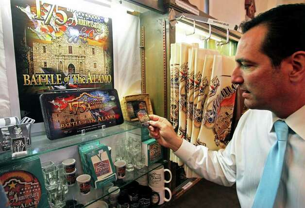 Alamo marketing director Tony Caridi looks through some of the items for sale commemorating the 175th anniversary of the Battle of the Alamo on January 6, 2011. Tom Reel/Staff Photo: TOM REEL, SAN ANTONIO EXPRESS-NEWS / © 2010 San Antonio Express-News
