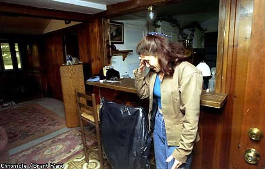 Shari Maguire enters her Rio Nido home for the first time in months. She is pleased that there isn't a lot of mold in the house and that all the house plants haven't died. She lives on Canyon 3 Road, one of the areas where residents were allowed to return today. By Brant Ward/Chronicle
