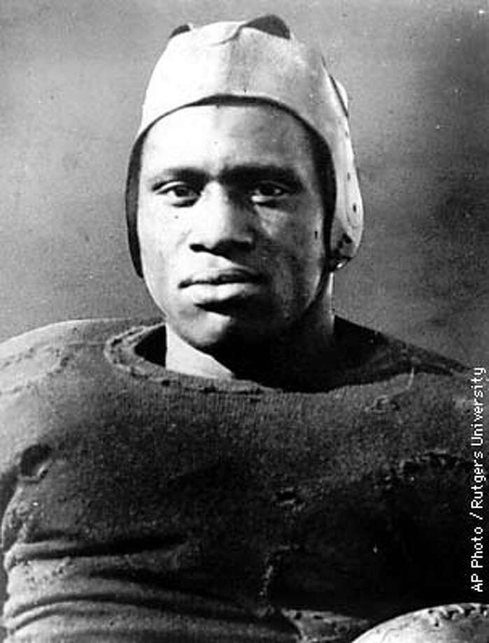 FILE-- , as shown in this file photo, was the greatest football player of his time, a renowned entertainer and a scholar. But he is best known for being what he really was not _ a communist. For nearly 50 years the former Rutgers player and first black to win back-to-back All-American honors (1917-18) was shunned because of his liberal beliefs and efforts to win equal rights for blacks. Now, 77 years after his final season, Robeson is taking his place in The College Football Hall of Fame. (AP Photo/Rutgers University, file)