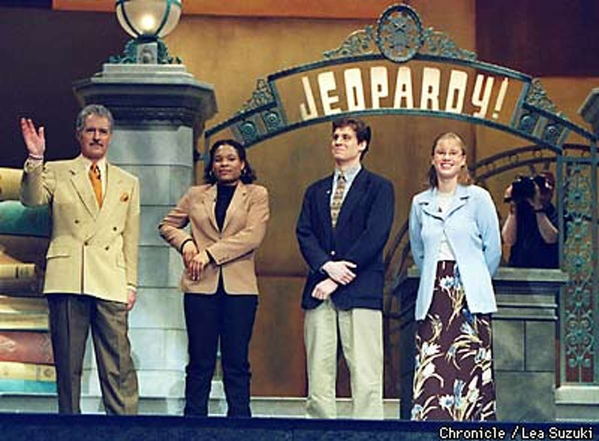 From left: Alex Trebek; Adia Benton, Jr. Brown University; Alex Weathers, Soph., MIT; Kristen Page, Jr., Mary Washington. Trebek and contestants, Benton, Weathers and Page finish the taping of a Jeopardy episode at Zellerbach Hall at UC Berkeley. Photo By Lea Suzuki