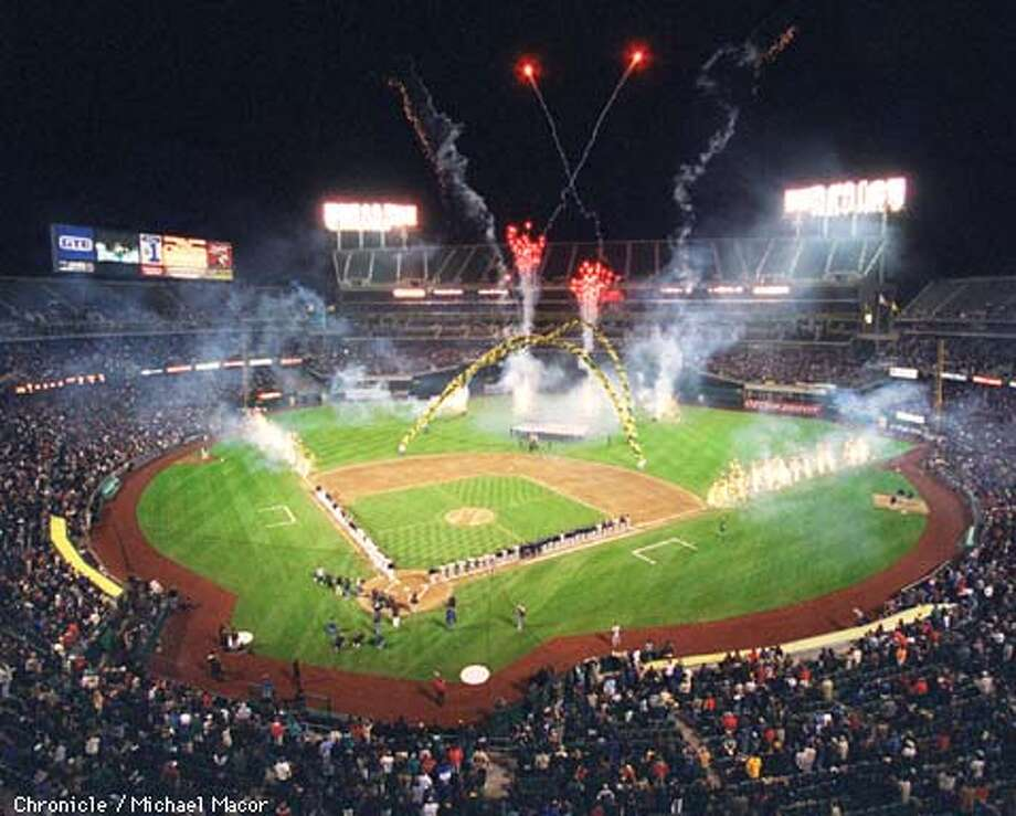 A'S FWORKS/C/01APR98/SP/MACOR The Oakland A's opening night at the Oakland Coliseum. Fireworks fills the stadium during the singing of the National Anthem. By Michael Macor/The Chronicle Photo: MICHAEL MACOR