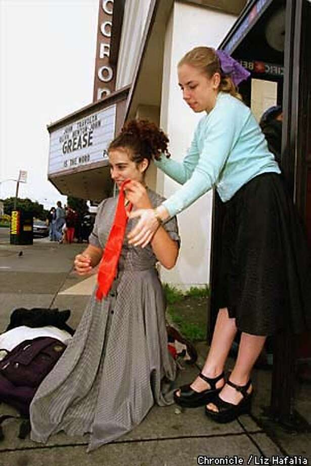 GREASE 1b/C/C/27MAR98/DD/LH--Alexis Nelson ties a red bow in Rose Loeb-Levine's hair next to Coronet Theatre before the show. Both of the girls are from Lowell High School. photo by Liz Hafalia Photo: Liz Hafalia