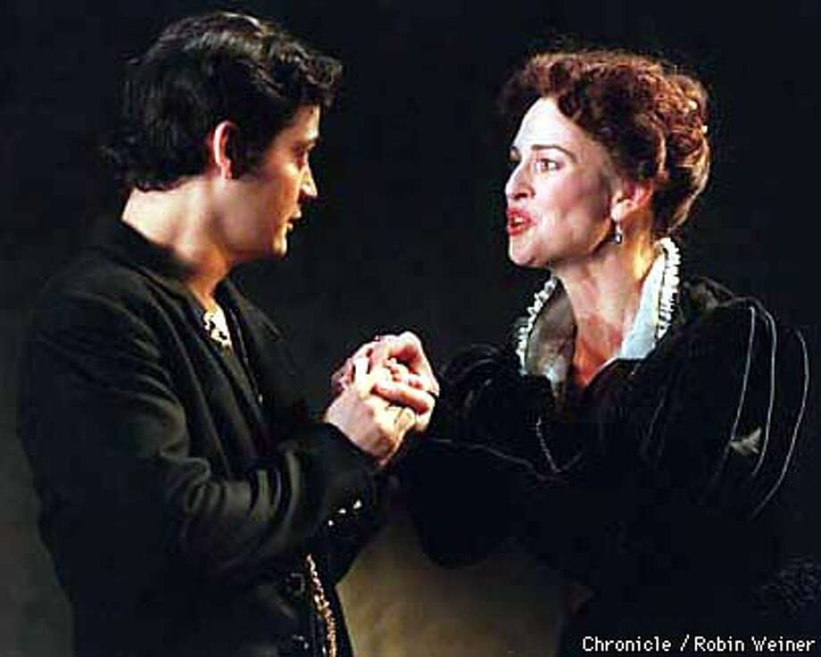 Susan Gibney, right, who plays the character Mary Stuart, Queen of Scotland, performs with Johnny Moreno, left, whose character is Mortimer, the Paulpet's nephew, in Mary Stuart at the Geary Theater in San Francisco. Robin Weiner/The Chronicle
