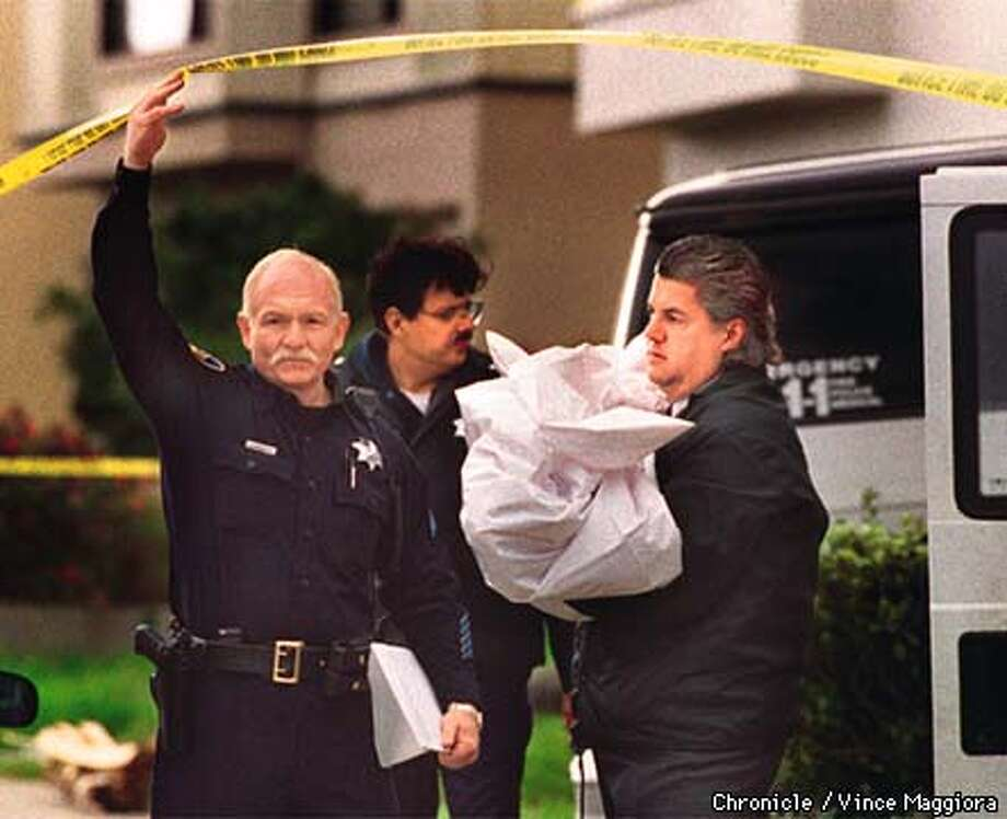 = A San Mateo County Coroner putting one of the dead children in to his van . the police found three dead children and their mother in a bedroom at 792 Highgate , Daly City. by Vince Maggiora Photo: VINCE MAGGIORA