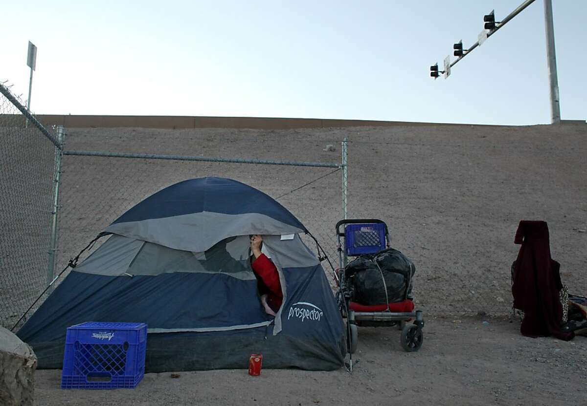With the unemployment rate being close to 17 percent and have more foreclosures than any other state people set up their tents and find themselves sleeping along the side of highway 15, Friday February 3, 2012, in Las Vegas, Nevada.