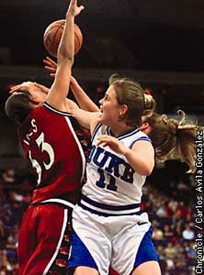 Duke's Hilary Howard, (11), and Arkansas's Karen Jones, (33), battle for a rebound in the first half of play in the NCAA Western Regional Championships at the Oakland Coliseum on Monday, March 23, 1998 (Chronicle photo by/Carlos Avila Gonzalez)