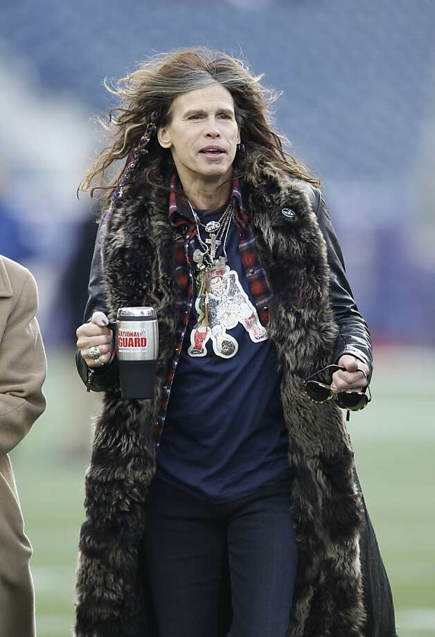 Aerosmith frontman Steven Tyler walks across the field before the AFC Championship NFL football game between the New England Patriots and Baltimore Ravens on Sunday, Jan. 22, 2012, in Foxborough, Mass. (AP Photo/Winslow Townson) Photo: Winslow Townson, Associated Press