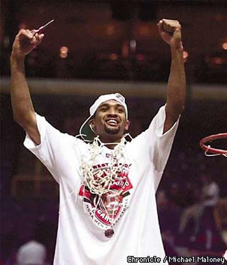 MVP Arthur Lee wears the net he just cut after Stanford beat Rhode Island.  Photo by Michael Maloney Photo: MICHAEL MALONEY