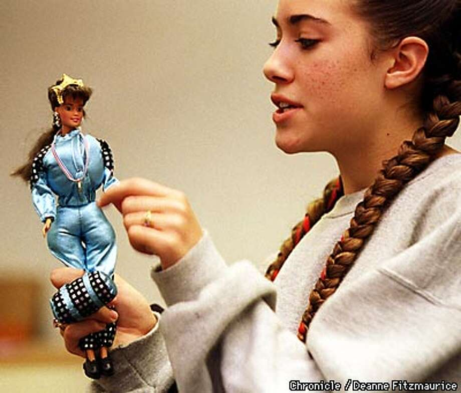 """Sarena (cq) Chandler, an eighth grader at Willard Jr. High School in Berkeley padded a Barbie with cotton balls and calls her """"Pleasantly Plump"""" Barbie. She attended a campus forum called """"Barbie's We'd Like To See"""". CHORNICLE PHOTO BY DEANNE FITZMAURICE"""