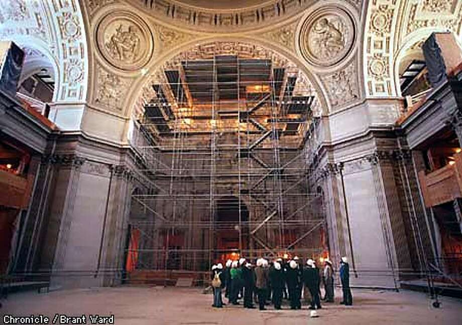 A tour of San Francisco City Hall featured a view from the rotunda and the scaffolding which reaches to the ceiling. The stairs have been covered with plywood during this part of the renovation. By Brant Ward/Chronicle