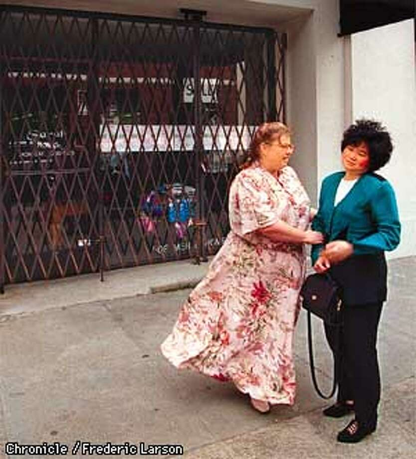 "GULCH/C/22MAR98/BU/FRL: Shopkeepers Stacey Turner (L) of Traditional White, a wedding gown store, and Sarah Kong owner of ""Sarah a children's clothing outlet are forced to move out of the tendy PacBell Park neighborhood because of furious buying that has boosted real estate prices in the area. Chronicle photo by Frederic Larson."