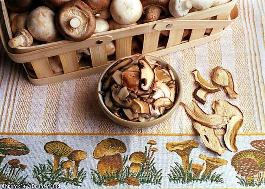 Various mushrooms both dried and fresh. Style by Maria Cianci. By Brant Ward/Chronicle