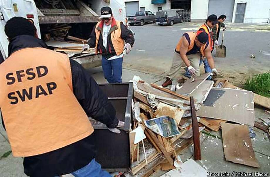 The Bayview District of San Francisco, one of the spots in California hit hardest by illegal dumping. A SWAP Team ( Sheriff's Work Alternative Program) cleans up a dump site at the end of Shafter Street. Photo: MICHAEL MACOR