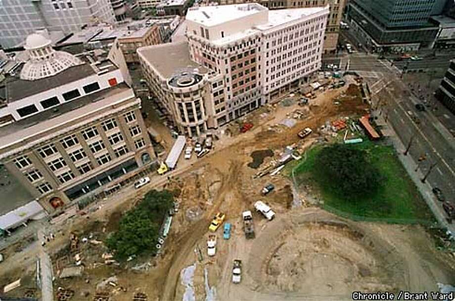A view from the top of the Oakland City Hall shows the Plaza area under construction. The outline of the ampitheatre can be seen, the Rotunda building is in upper right. By Brant Ward/Chronicle
